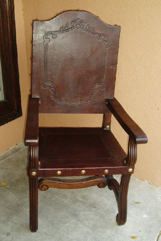 hand tooled leather armchair in Olinda Romani's Valencia design made in Peru