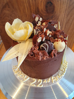 Chocolate cake with floral decoration