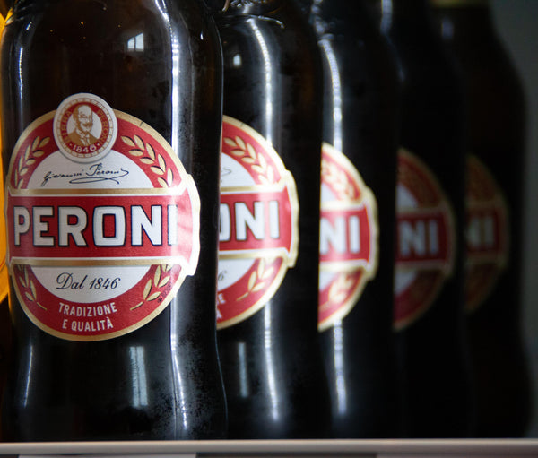 Bottles of Peroni lined up in the Pip Stop Fridge
