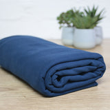Navy brushed back french terry fabric on wooden table