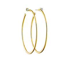 looped diamond ear rings in 18 carat gold