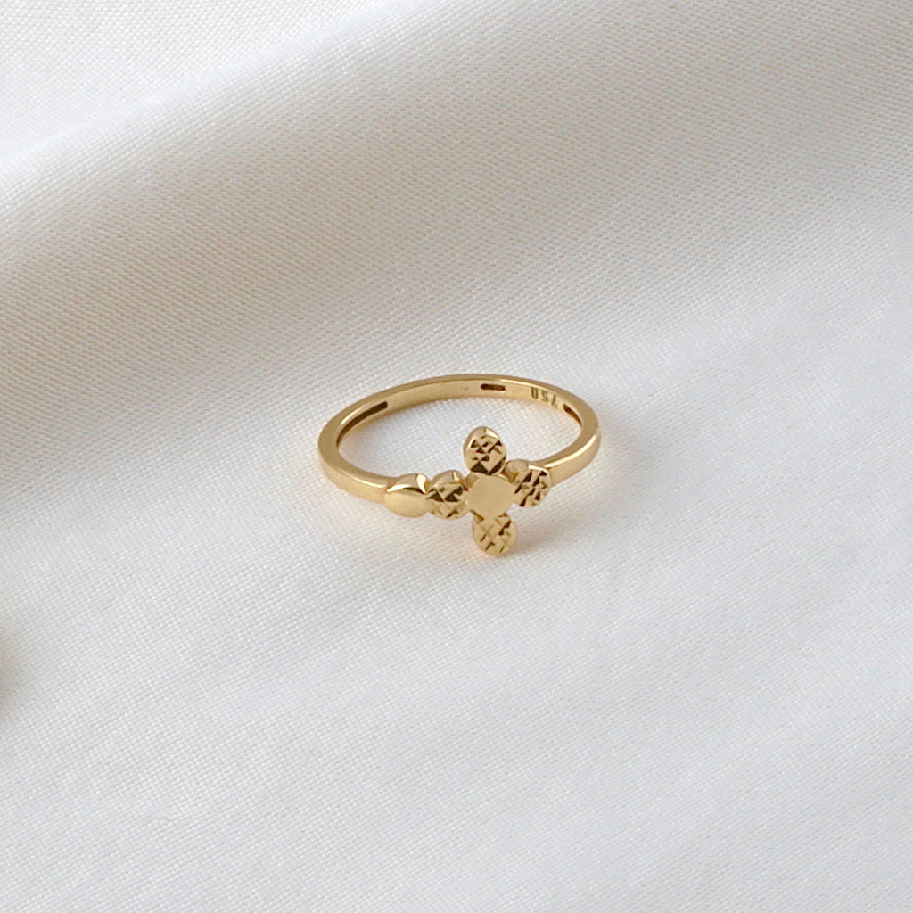 A beautiful gold Celtic inspired golden cross ring with intricate detailing and beautiful delicate poise.