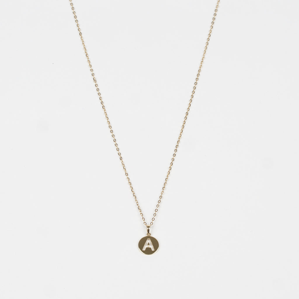 This charming piece is an effortlessly stylish Pure 18k Gold Necklace plus a Pure 18k Gold disc with a letter of the alphabet beautifully cut through the disc.
