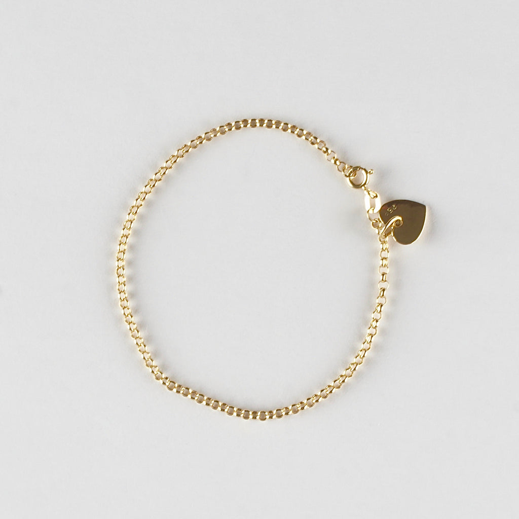 Delicately crafted bracelet with a heart-shaped charm motif.