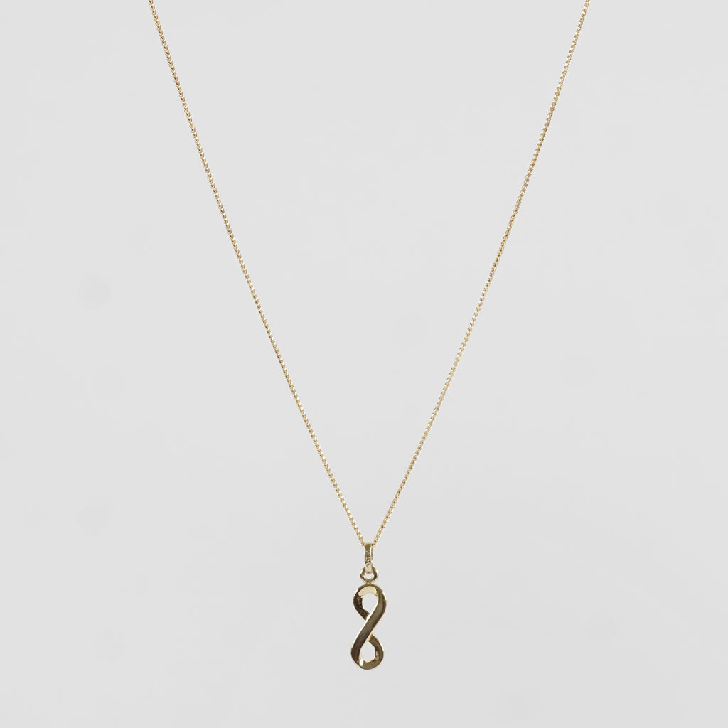 A stunningly beautiful infinity hoop-shaped Pure 18k Gold pendant adorning a Pure 18k Gold chain