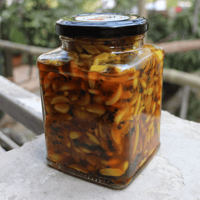Garlic Pickle in a glass bottle, Net Weight 400gms. Prepared by Home Sweet Home Pickle