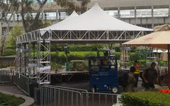 Stretch tent truss stage