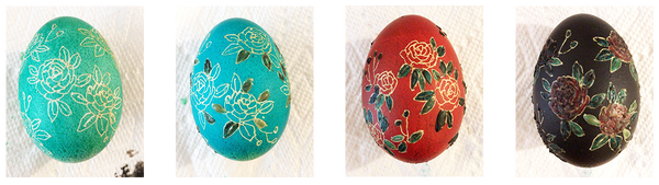 Images of four eggs, each with one colour added to a flower design