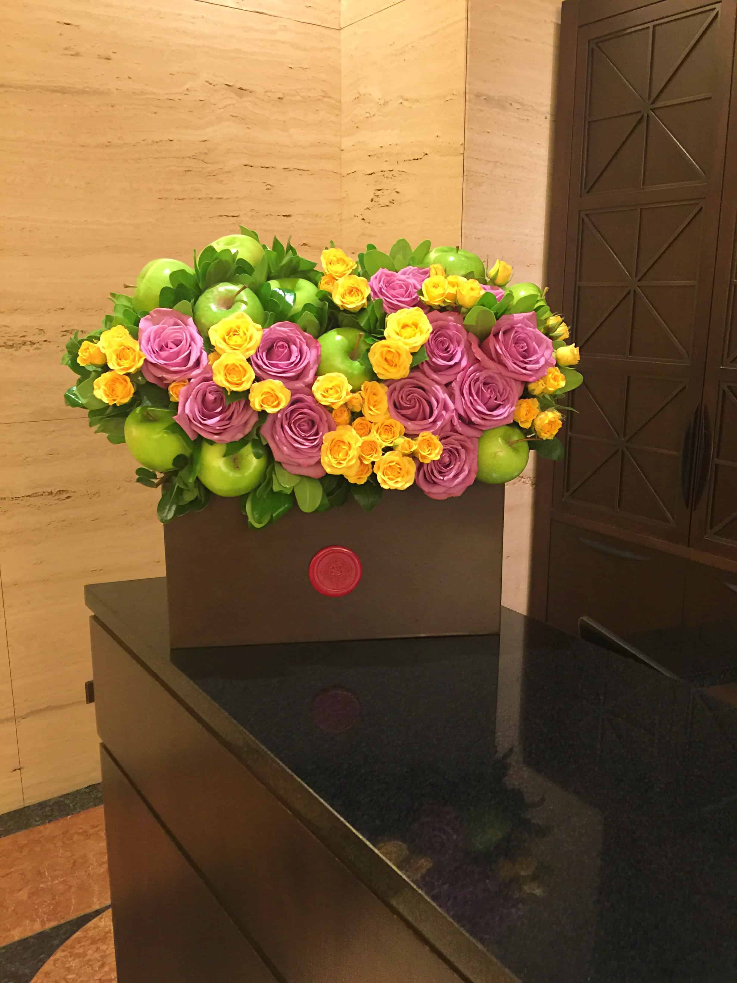 Lavender roses, yellow spray roses, Korean melon, gala melon, green apples and ume fruit