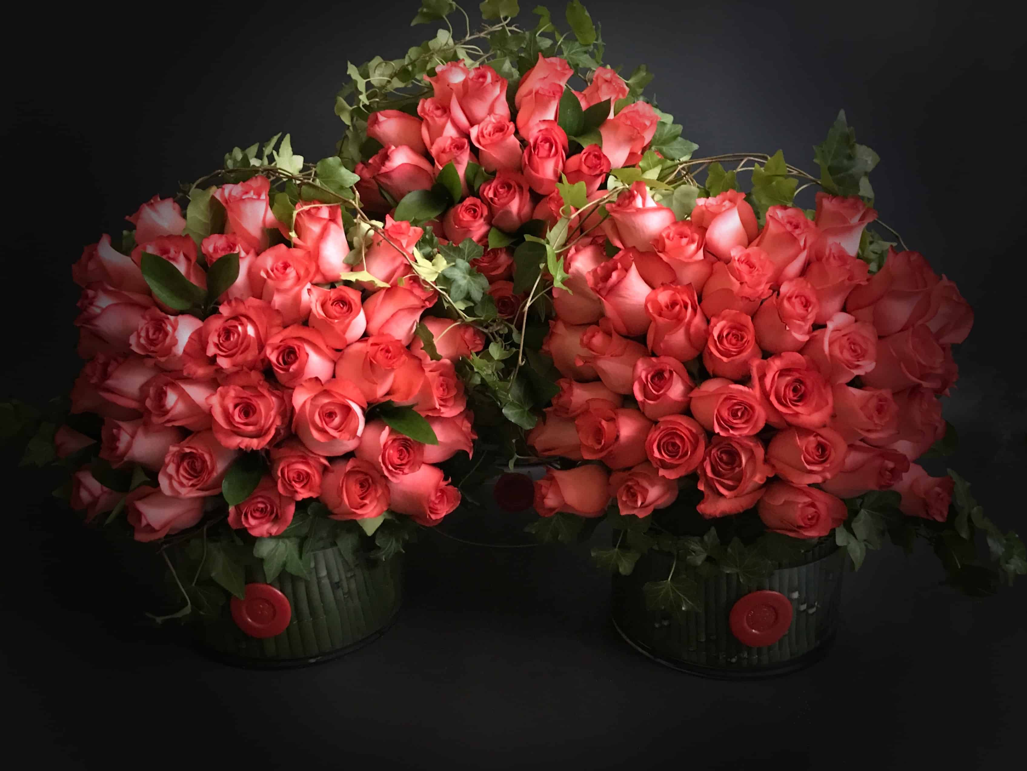 Premium roses wrapped in ivy mounted over a glass cylinder meticulously lined with horsetail