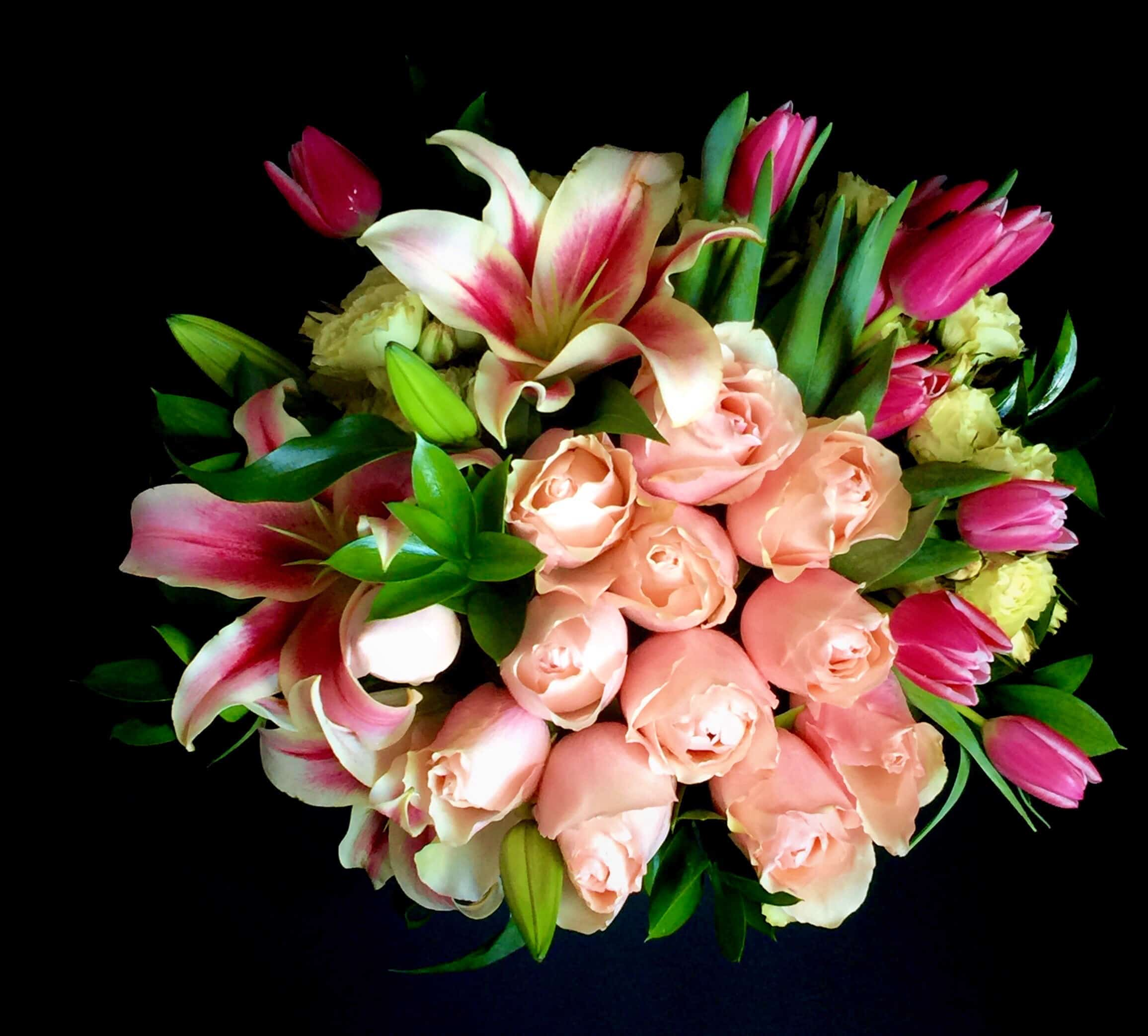 Handpicked fresh seasonal blooms in pink and white shades