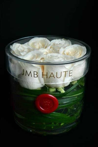 Clear round rose box small size with premium white roses lined with green leaves