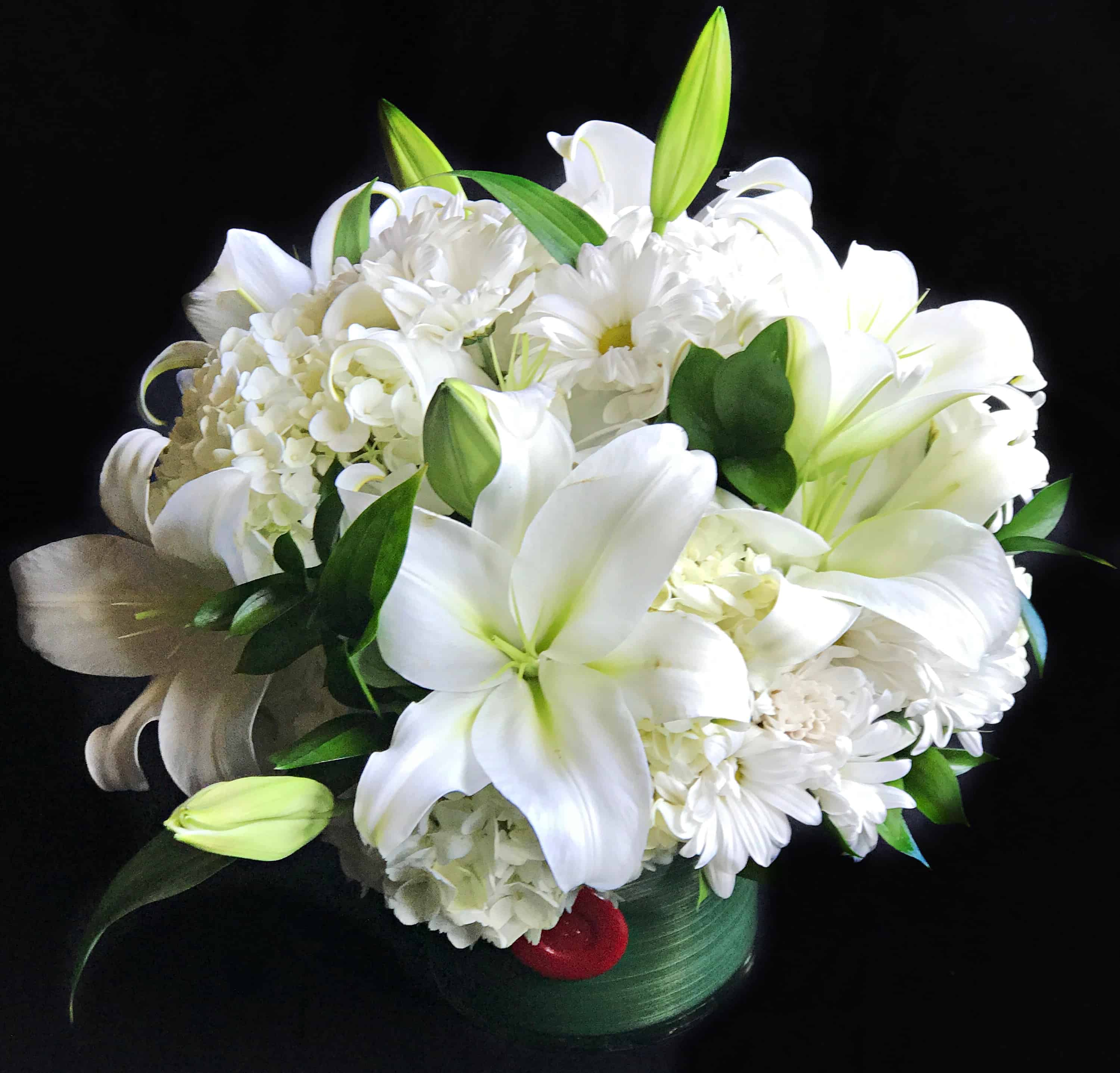White flower arrangement naperville florist flower delivery by classic white flower arrangement with seasonal blooms in a lined glass cylinder mightylinksfo Image collections
