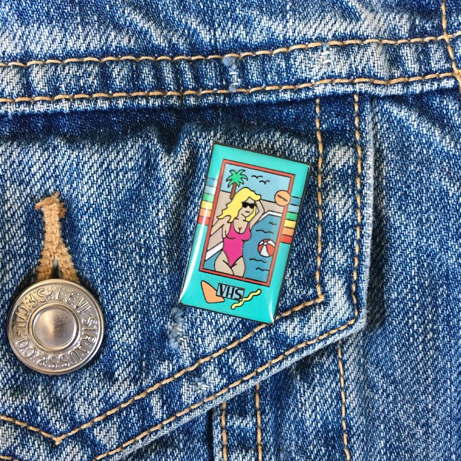 Radical Rewind-Inclined Stuff Alert: The BEACH BABE VHS Enamel Pin from Afterschool Spectral!