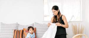 Mother and child folding laundry