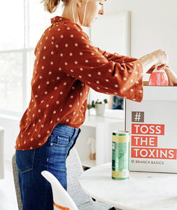 Founder Allison Evans tossing toxic cleaners