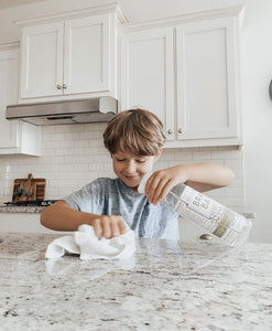 Boy cleaning with All-Purpose Spray