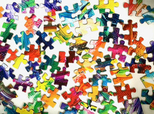 Many multicolored, gradiant, rainbow, puzzle pieces on a white background