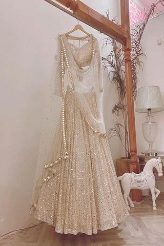 Adorning Cream Color Heavy Work Style Lehenga Choli IS4756