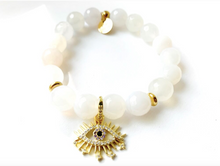 Load image into Gallery viewer, Stud Muffin 10mm faceted agate + gold-plated starburst eye