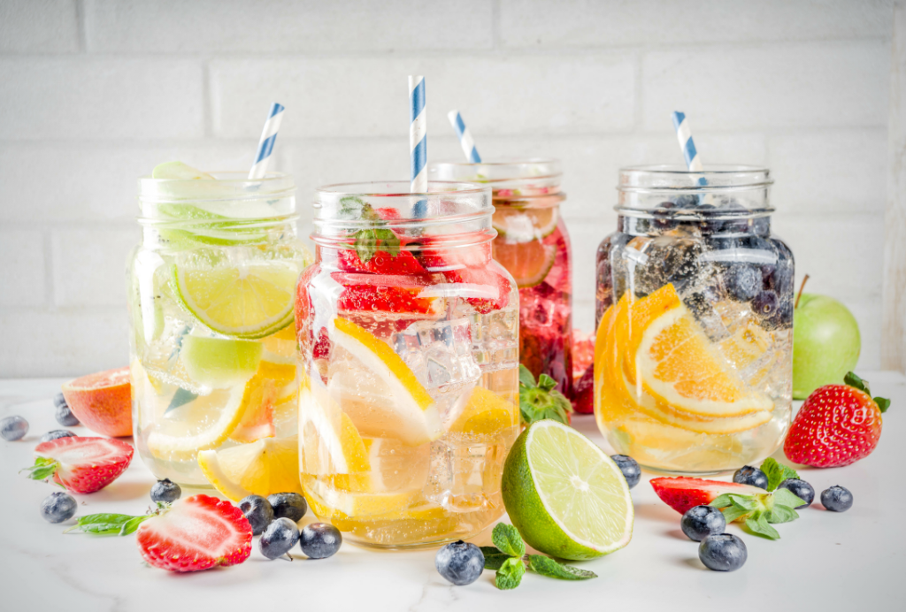 Fruit infused waters in mason jars with straws
