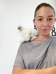 owner Leanne Luce with favorite chicken Blanche at Studio Cluck