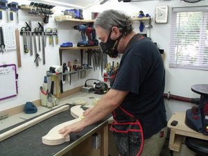 Davy C working with one of his harp creations