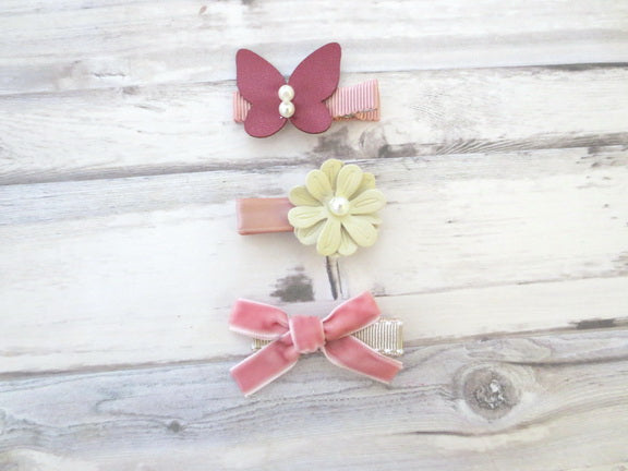 A set of three hair clips - Butterfly, Flower, and Velvet Bow