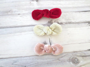A set of three velvet knotted bow hair clips