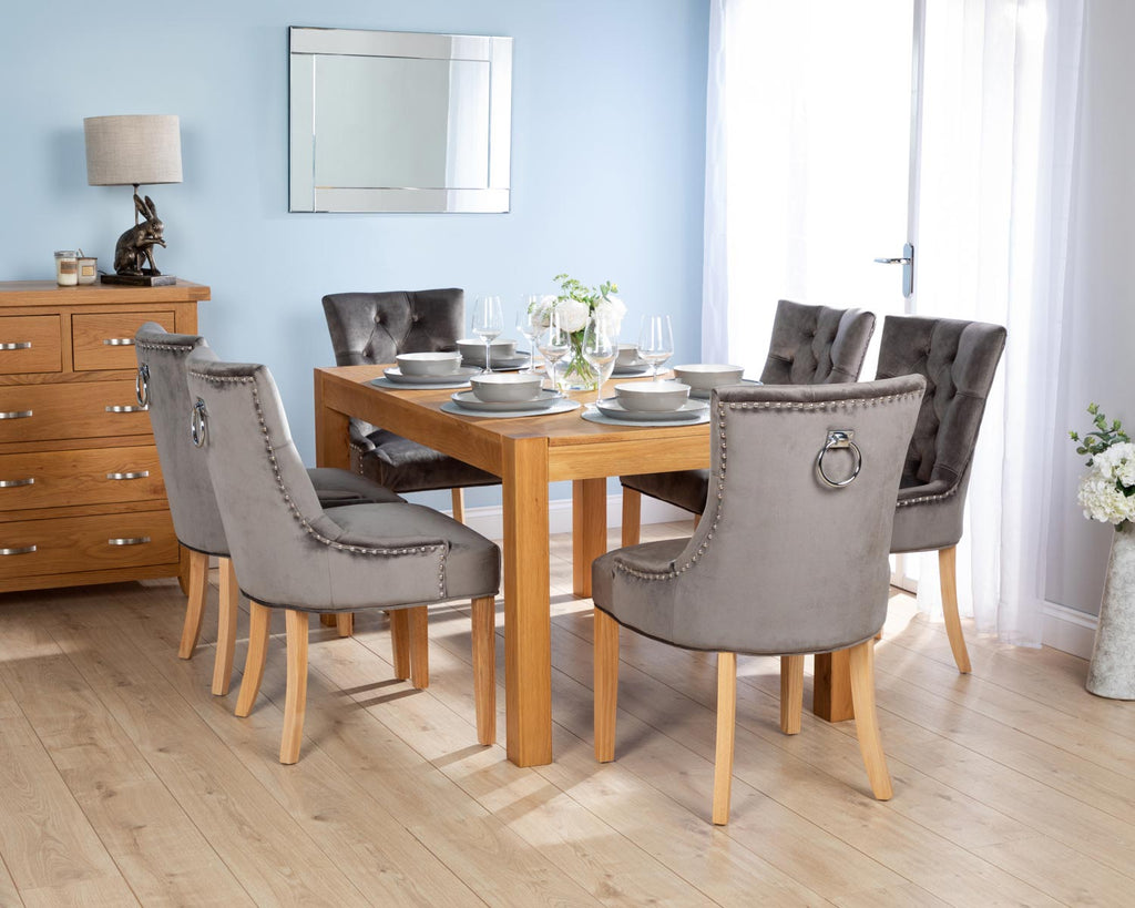 Rectangular Oak Dining Table and 6 Grey Velvet Verona Dining Chairs with Chrome Knocker and Oak Legs