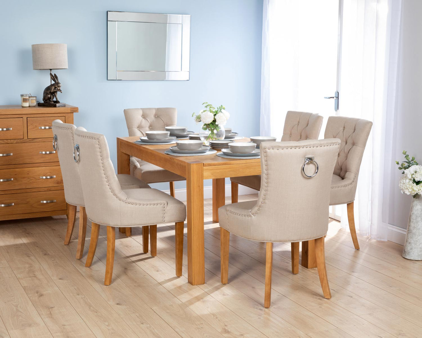 Rectangular Oak Dining Table and 6 Cream Linen Verona Dining Chairs with Chrome Knocker and Oak Legs