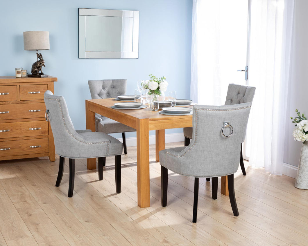 Rectangular Oak Dining Table and 4 Grey Linen Verona Dining Chairs with Chrome Knocker and Black Legs