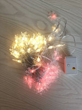 Load image into Gallery viewer, LuxKazsazzi lamps for festive decoration,100 LED christmas snowflake string lights, 49 FT plug in fairy light waterproof