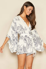 Fashion White Navy Floral Print Ruffle Tie-Up Romper