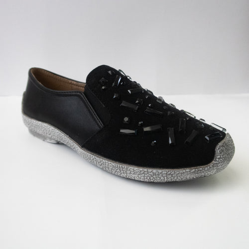 Black slip-on sneakers with black chunky crystals and a gray sole.