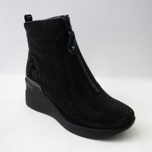 Black crystal wedge boots with a zip-up upper.