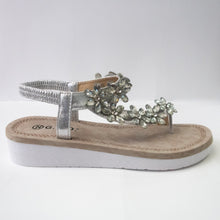 Load image into Gallery viewer, A silver toe-ring sandal with crystal flower embellishments trailing from the toe-ring to upper-strap.