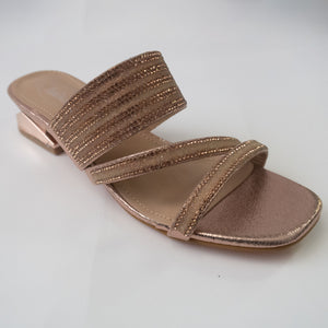 Rose gold strappy sandals with a metallic block heel.  Crystal embellished straps. Reflective metallic block heel.