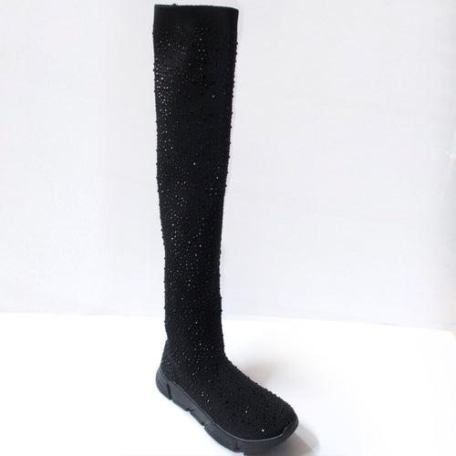 Black knee-high sock sneaker boot hybrid with crystal embellishments. Stretchy sock-knit upper embellished with black crystals. Pull-on style. Black sneaker-like soles.