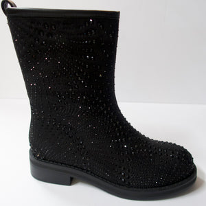 Black boots with a side-zipper.   Inner side-zipper. Cut at the mid-calf. Round-toe. Suede-like upper with black crystal embellishments.