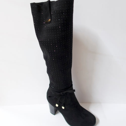 Crystal-embellished black knee-high boots with a side-bow on the ankle. Inner side zipper. Suede-like upper with black crystal embellishments. Block heel.