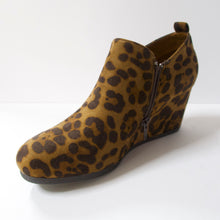Load image into Gallery viewer, Cheetah print ankle booties with a wedge heel. Inner-side zipper and elasticated opening. Wedge heel.