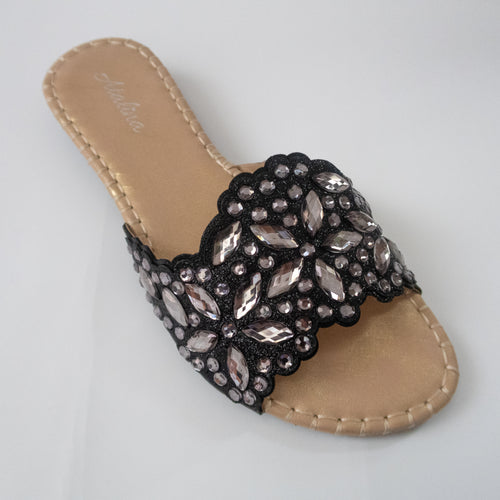 Black slip-on flat sandals embellished with silver crystals.