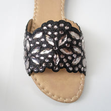 Load image into Gallery viewer, Black slip-on flat sandals embellished with silver crystals.