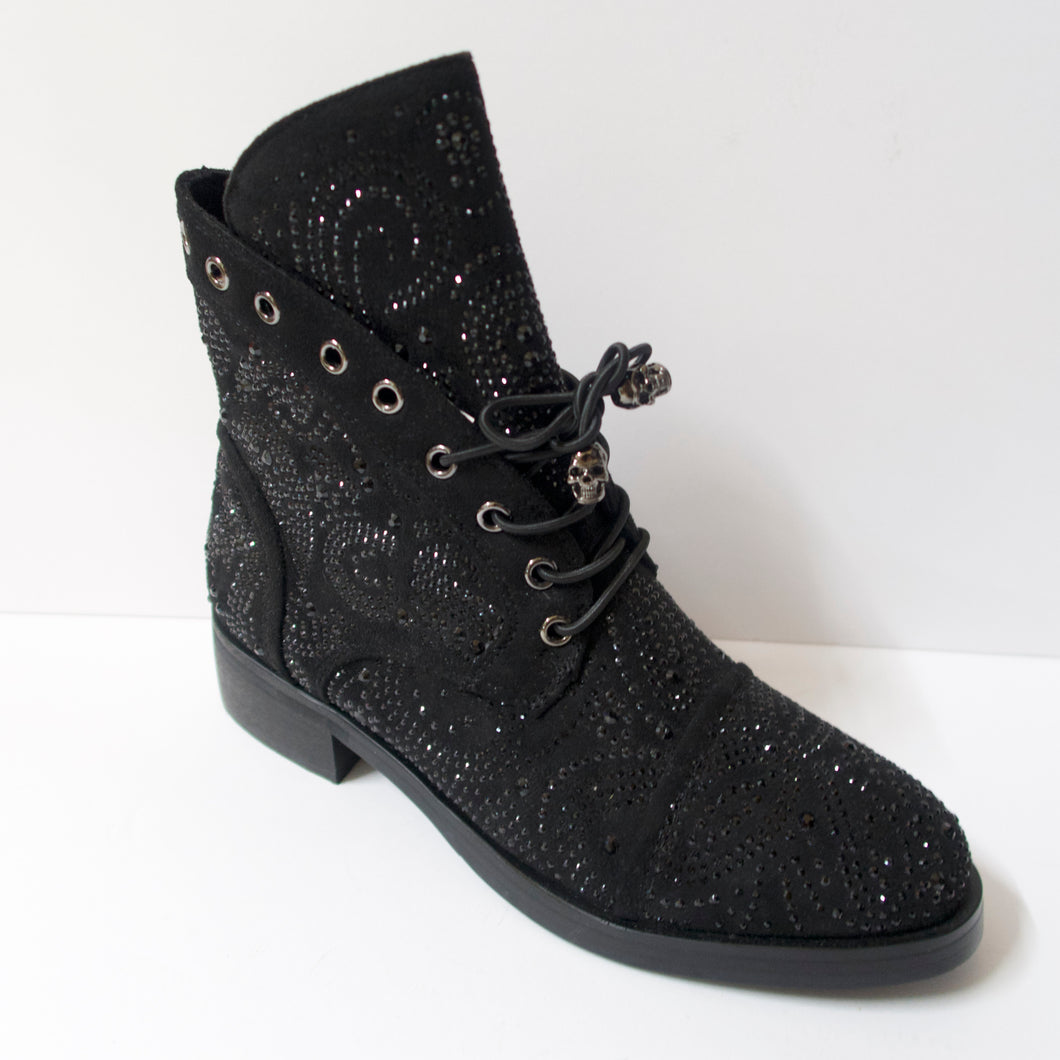 Black ankle booties with skull shoelaces and crystal embellishments. Slight heel. Black crystal embellished upper. Shoelaces with a skull aglet.