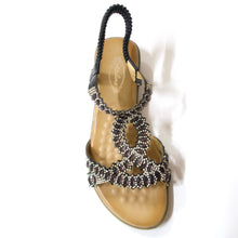Load image into Gallery viewer, A comfortable open-toe sandal with black crystal-embellished upper straps.