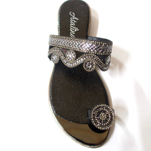 A black toe-ring sandal with crystal embellishments.