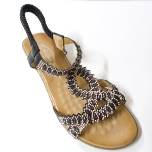 A comfortable open-toe sandal with black crystal-embellished upper straps.