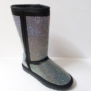 Black winter boots covered in crystal embellishments. Hit the mid-to-upper calf. Entire boot embellished with iridescent silver crystals.  Fuzzy lining on the insides, including the sole to add warmth.  Textured outsole for traction.