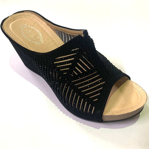 Black slip-on wedge sandals with rhinestones and a cut-out pattern decorating the strap.  Easy to slip on. Black crystals embellishing the upper strap.